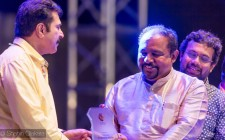 "Padma Shri Dr. Sundar Menon  receiving memento from Superstar Padmashri Mamooty in a stage program organized  by Kairali channel ""Mohabathein With Mammukka"" held at Asian Town Amphitheatre in Qatar."